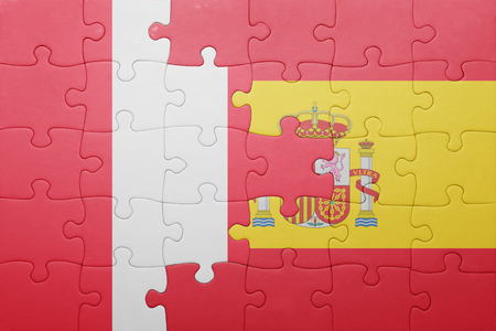 lima region: puzzle with the national flag of spain and peru . concept Stock Photo