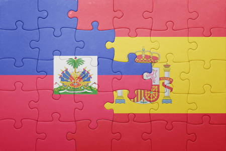 port au prince: puzzle with the national flag of spain and haiti . concept