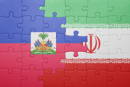 port au prince: puzzle with the national flag of haiti and iran . concept
