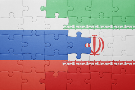 russia flag: puzzle with the national flag of russia and iran . concept