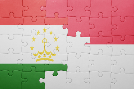 economy of tajikistan: puzzle with the national flag of indonesia and tajikistan . concept