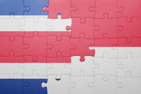 costa rican flag: puzzle with the national flag of indonesia and costa rica . concept