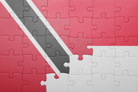 puzzle with the national flag of indonesia and trinidad and tobago . concept