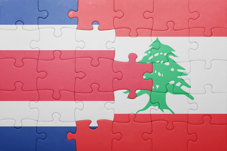 costa rican flag: puzzle with the national flag of costa rica and lebanon . concept