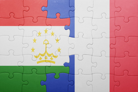 economy of tajikistan: puzzle with the national flag of tajikistan and france . concept