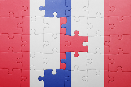 lima region: puzzle with the national flag of peru and france . concept Stock Photo