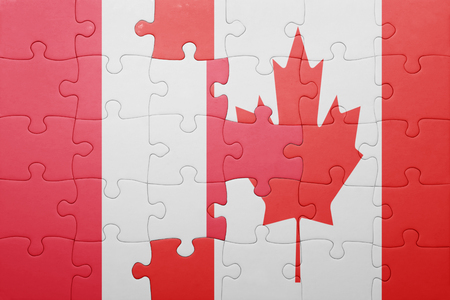 lima region: puzzle with the national flag of canada and peru . concept Stock Photo