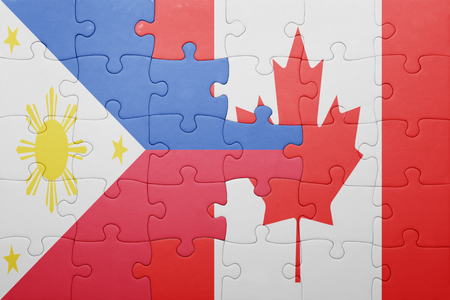 puzzle with the national flag of canada and philippines . concept