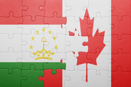 economy of tajikistan: puzzle with the national flag of canada and tajikistan . concept