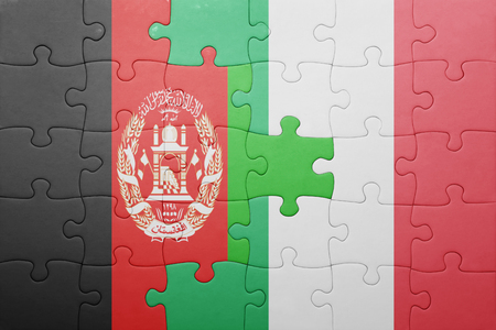 afghan flag: puzzle with the national flag of italy and afghanistan . concept Stock Photo