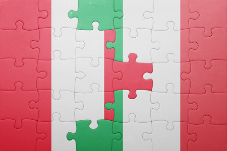 lima region: puzzle with the national flag of italy and peru . concept