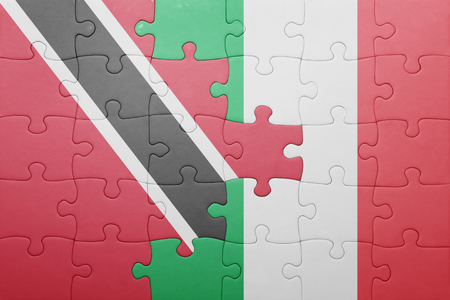 national flag trinidad and tobago: puzzle with the national flag of italy and trinidad and tobago . concept
