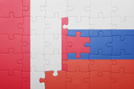 lima region: puzzle with the national flag of peru and russia . concept Stock Photo