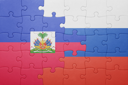 port au prince: puzzle with the national flag of haiti and russia . concept Stock Photo