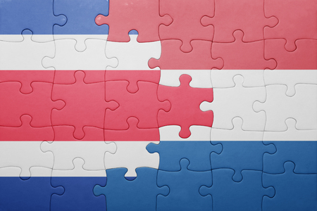 costa rican flag: puzzle with the national flag of netherlands and costa rica . concept Stock Photo