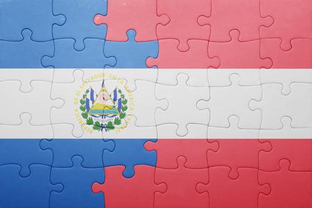 el salvadoran: puzzle with the national flag of el salvador and austria . concept