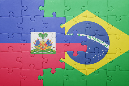 puzzle with the national flag of haiti and brazil . concept