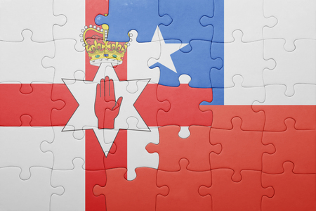 northern ireland: puzzle with the national flag of chile and northern ireland . concept