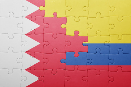 middle east conflict: puzzle with the national flag of colombia and bahrain . concept Stock Photo