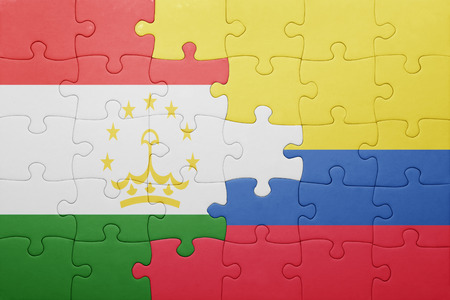 economy of tajikistan: puzzle with the national flag of colombia and tajikistan . concept