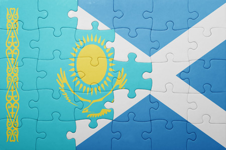 puzzle with the national flag of kazakhstan and scotland . concept