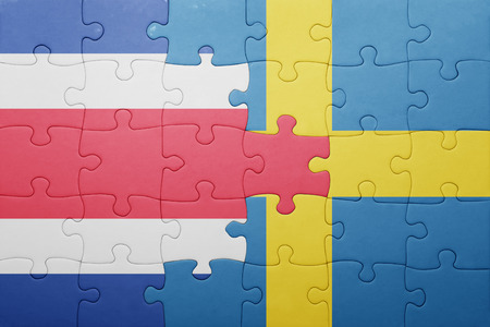 costa rican flag: puzzle with the national flag of sweden and costa rica . concept Stock Photo