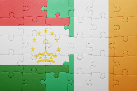 economy of tajikistan: puzzle with the national flag of ireland and tajikistan . concept Stock Photo