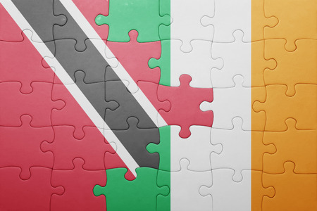 national flag trinidad and tobago: puzzle with the national flag of ireland and trinidad and tobago . concept Stock Photo