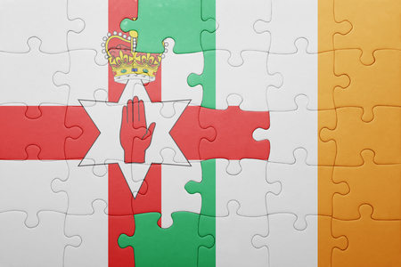 northern ireland: puzzle with the national flag of ireland and northern ireland . concept