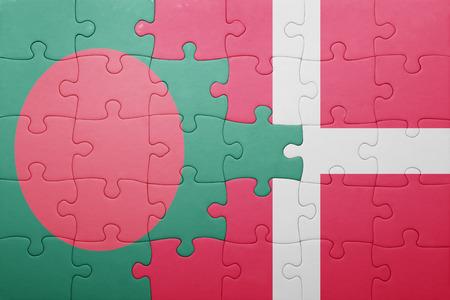 national flag bangladesh: puzzle with the national flag of bangladesh and denmark . concept