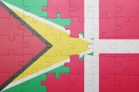 banderas americanas: puzzle with the national flag of guyana and denmark . concept