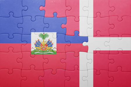 port au prince: puzzle with the national flag of haiti and denmark . concept