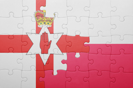 northern ireland: puzzle with the national flag of northern ireland and poland . concept Stock Photo