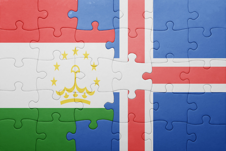 economy of tajikistan: puzzle with the national flag of tajikistan and iceland . concept