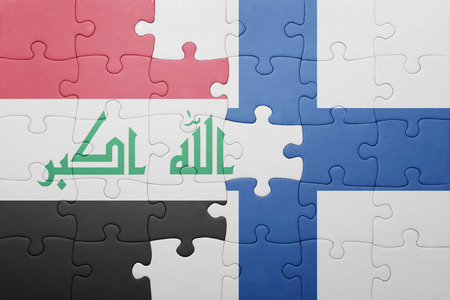 middle east conflict: puzzle with the national flag of iraq and finland . concept
