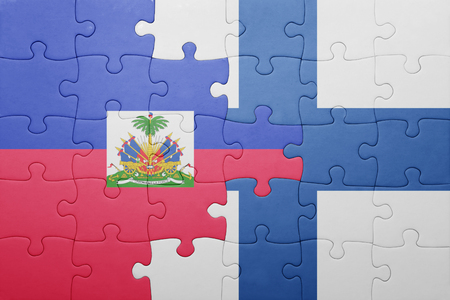 port au prince: puzzle with the national flag of haiti and finland . concept