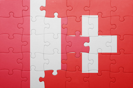 lima region: puzzle with the national flag of switzerland and peru . concept