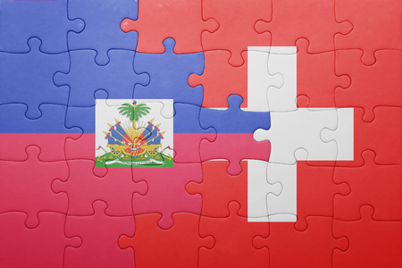 port au prince: puzzle with the national flag of switzerland and haiti . concept Stock Photo