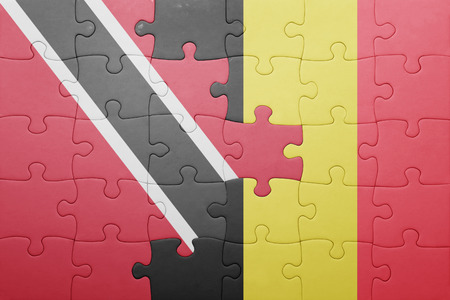 national flag trinidad and tobago: puzzle with the national flag of trinidad and tobago and belgium . concept