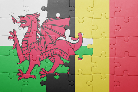 gb: puzzle with the national flag of wales and belgium . concept