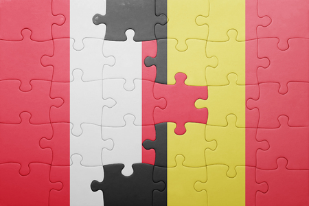 lima region: puzzle with the national flag of peru and belgium . concept Stock Photo