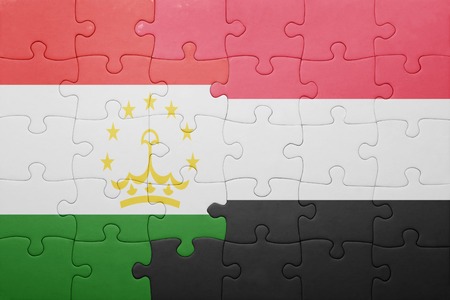 economy of tajikistan: puzzle with the national flag of tajikistan and yemen . concept