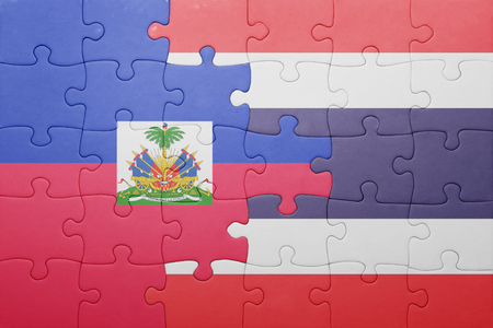 puzzle with the national flag of haiti and thailand . concept
