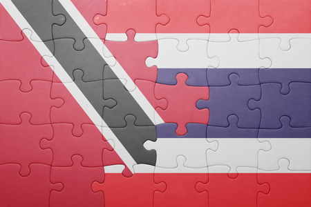 national flag trinidad and tobago: puzzle with the national flag of trinidad and tobago and thailand . concept