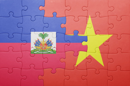 port au prince: puzzle with the national flag of haiti and vietnam . concept