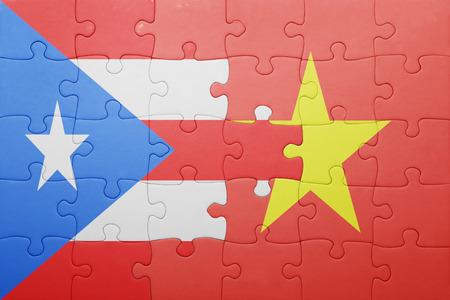 bandera de puerto rico: puzzle with the national flag of puerto rico and vietnam . concept Foto de archivo