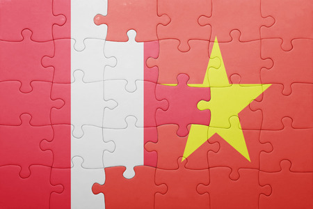 lima region: puzzle with the national flag of peru and vietnam . concept Stock Photo
