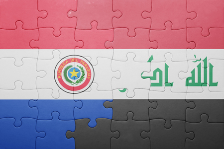 iraqi: puzzle with the national flag of paraguay and iraq . concept