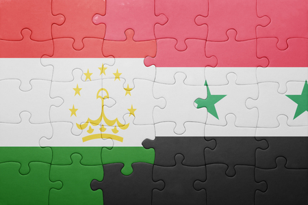 economy of tajikistan: puzzle with the national flag of tajikistan and syria . concept