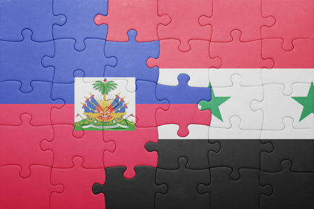 haitian: puzzle with the national flag of haiti and syria . concept
